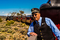 Train conductor, Cumbres & Toltec Scenic Railroad train on the 64 mile run between Antonito, Colorado and Chama, New Mexico.The railroad is the highest and longest narrow gauge steam railroad in the United States with a track length of 64 miles. The train traverses the border between Colorado and New Mexico, crossing back and forth between the two states 11 times. The narrow gauge track is 3 feet wide. It runs over 10,015 ft (3,053 m) Cumbres Pass.