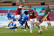 Brighton and Hove Albion defender Tariq Lamptey (2) goes to ground after a challenge from Erik Pieters of Burnley (23)   during the Premier League match between Burnley and Brighton and Hove Albion at Turf Moor, Burnley, England on 26 July 2020.