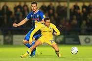 Harrison McGahey challenges Kyle Bennett during the EFL Sky Bet League 1 match between Rochdale and Bristol Rovers at Spotland, Rochdale, England on 2 October 2018.