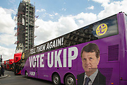 UK Independence Party European election campaign bus with party leader Gerard Battens face across it passes the Houses of Parliament on 10th May 2019 in London, England, United Kingdom. UKIPs manifesto claims that Brexit is being betrayed and to make Brexit happen voters should vote for them.