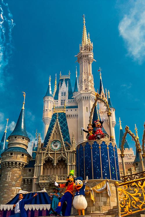 Disney characters perform in front of the Cinderella Castle, Magic Kingdom, Walt Disney World, Orlando, Florida USA