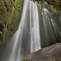 Iceland has no shortage of waterfalls and each one is unique and beautiful.  This one seemingly falls out of nowhere in a partially enclosed cave.