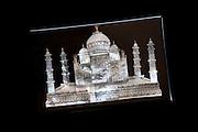 Taj Mahal souvenir, mother of pearl inlay on black onyx marble, on sale at Subhash Emporium, Agra, India
