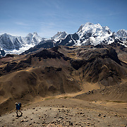 A hiker makes his way in front of Jirishanca and Yerupaja mountains at the Cordillera Huayhuash trekking circuit, Peru, September 6, 2018. REUTERS/Lisi Niesner