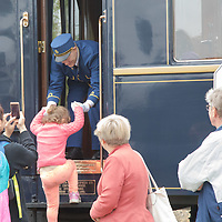 Steward helps on people visiting cars of the Venice Simplon Orient Express open for the audience at the Hungarian Railway Museum in Budapest, Hungary on Aug. 26, 2018. ATTILA VOLGYI