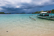 A bangka boat is parked at Paradise Island, one of several stops in a day-long boat tour out of Port Barton, Palawan, Philippines.<br /><br />(July 7, 2019)