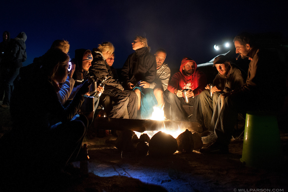 Mongol Rally teams from a handful of countries share adventure stories off the side of the road in Govi-Altai Province, just days from the finish line in Ulaanbaatar. Once perfect strangers, countless car repairs, border crossings and other obstacles have brought them together.