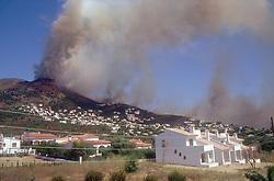 Fire on hillside near Roses Rosas Catalunya,
