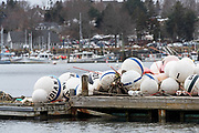 Mooring buoys stored on a float for the winter, Northeast Harbor, Maine.