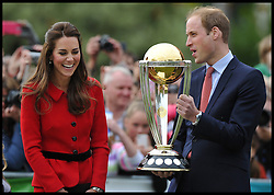 The Duke and Duchess of Cambridge hold up the cricket world cup before playing cricket in a 2015 Cricket World Cup event in Christchurch, New Zealand on day 8 of the Royal Tour of New Zealand and Australia. Monday, 14th April 2014. Picture by Andrew Parsons / i-Images
