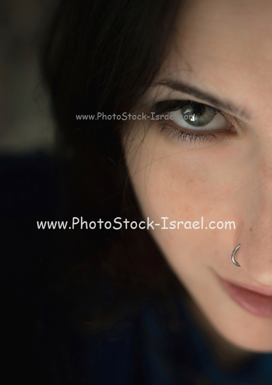 portrait of a young hip woman with a nose ring