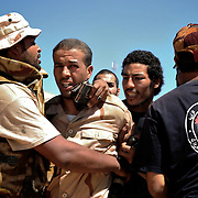 Libyan rebels detain a snipper from Gaddafi's troops outside Zawiya.