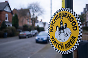 Sign for a neighbourhood watch area in Moseley on 12th february 2021 in Birmingham, United Kingdom. Neighbourhood Watch in the United Kingdom is the largest voluntary crime prevention movement covering England and Wales with upwards of 2.3 million household members. The charity brings neighbors together to create strong, friendly and active communities in which crime can be tackled.