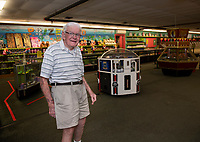 Bob Lawton prepares to open on Monday with social distancing guidelines in place at Funspot in Weirs Beach.  (Karen Bobotas/for the Laconia Daily Sun)