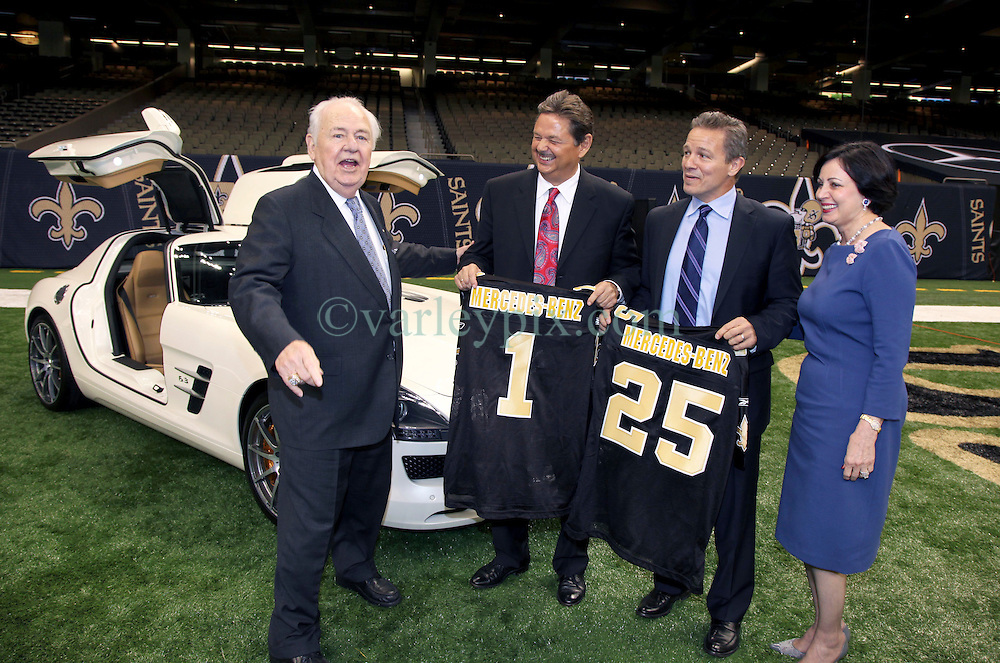 04 October 2011. New Orleans, Louisiana, USA.  <br /> NFL's New Orleans Saints announce a multi million dollar deal with Mercedes-Benz for naming rights on the Louisiana Superdome. Now the Mercedes-Benz Superdome. L/R  Tom Benson (owner Saints), Mercedes-Benz USA President and CEO Ernst Leib and Mercedes-Benz VP Marketing Stephen Cannon and Gayle Benson.<br /> Photo; Charlie Varley/varleypix.com