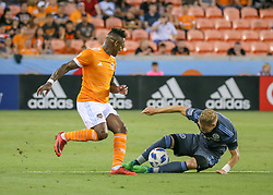 May 25, 2018 - Houston, TX, U.S. - HOUSTON, TX - MAY 25:  New York City defender Anton Tinnerholm (3) traps the ball and keeps it away from Houston Dynamo forward Romell Quioto (31) during the MLS match between the New York FC and Houston Dynamo on May 25, 2018 at BBVA Compass Stadium in Houston, Texas.  (Photo by Leslie Plaza Johnson/Icon Sportswire) (Credit Image: © Leslie Plaza Johnson/Icon SMI via ZUMA Press)