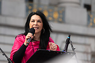 San Francisco, USA. 19th January, 2019. The Women's March San Francisco begins with a rally at Civic Center Plaza in front of City Hall. Plaza. Gilda Gonzales, CEO of Planned Parenthood NorCal (Northern California) addresses the audience. Credit: Shelly Rivoli/Alamy Live News