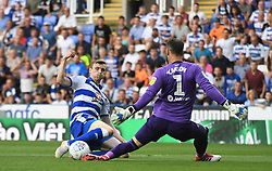 Reading's Jon Dadi Bodvarsson (left) and Derby County goalkeeper Scott Carson (right) battle for the ball