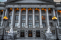 The Eastern entrance to the Utah State Capitol building in Salt Lake City at dusk.  The evening lights are turned on contrasting against the monochrome nature of the building.