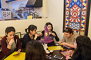 Eylem Gültekçe (centre rear) with other members of the Kampüs Cadıları (Campus witches) make placards for the upcoming international women's day on March 8th 2018, at a cafe in Kadıköy district of Istanbul, Turkey.