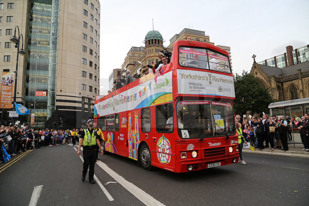 © Licensed to London News Pictures. 28/09/2016. Leeds, UK. One of many open top buses carrying olympic stars passes through Leeds city centre. Yorkshire's Olympic and Paralympic stars receive a heroes' welcome during an open top bus parade in Leeds, West Yorkshire. . Photo credit : Ian Hinchliffe/LNP