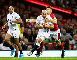 Willi Heinz of England under pressure from Dan Biggar of Wales<br /> <br /> Photographer Simon King/Replay Images<br /> <br /> Friendly - Wales v England - Saturday 17th August 2019 - Principality Stadium - Cardiff<br /> <br /> World Copyright © Replay Images . All rights reserved. info@replayimages.co.uk - http://replayimages.co.uk