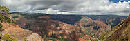 On the left of this view of Waimea Canyon is a very tall waterfall.