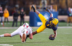 Oct 2, 2021; Morgantown, West Virginia, USA; West Virginia Mountaineers wide receiver Winston Wright Jr. (1) holds onto a catch while being tackled by Texas Tech Red Raiders linebacker Colin Schooler (17) during the fourth quarter at Mountaineer Field at Milan Puskar Stadium. Mandatory Credit: Ben Queen-USA TODAY Sports