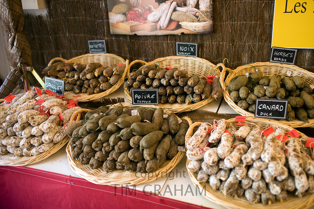 Duck pepper boar herb walnut and hazelnut sausages on sale in Brantome, Dordogne, France