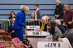 Maidenhead, UK. 13 December, 2019. Former Prime Minister Theresa May (Conservative) speaks to counting staff at the general election count for the Maidenhead constituency.