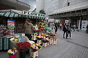 Flower stall in the public outdoor space at the Bullring in Birmingham, United Kingdom. The Bullring is a major commercial area of central Birmingham. It has been an important feature of Birmingham since the Middle Ages, when its market was first held. Two shopping centres have been built in the area in the 1960s, and then in 2003 the latter is styled as one word, Bullring.