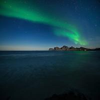 Northern lights in sky over Storsandnes beach, Flakstadøy, Lofoten Islands, Norway