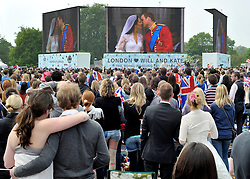 © under license to London News Pictures. LONDON, UK  28/04/2011. The Royal Wedding of HRH Prince William to Kate Middleton.  People watch the couple have their first kiss on giant screens in Hyde Park, London. Photo credit should read Stephen Simpson/LNP. Please see special instructions.