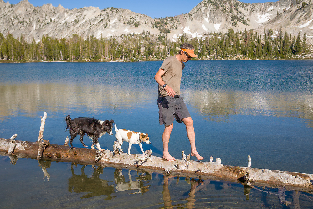 Pierre shows off walking a floating log with his dogs on Twin Lakes in the Sawtooth Mountains in Idaho.  Licensing and Open Edition Prints.