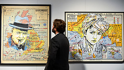 "© Licensed to London News Pictures. 04/10/2019. LONDON, UK. A staff member views (L to R) ""Churchill"", 2019, and ""Turban Kid"", 2019, both by C215 at the Mazel Galerie stand at Moniker International Art Fair, an urban contemporary art fair taking celebrating its 10 year anniversary in the UK.  The fair is  place at Chelsea's Sorting Office air until 6 October 2019.  Photo credit: Stephen Chung/LNP"