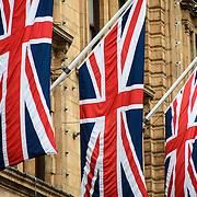 Three Union Jacks adorn the outside of Harrods department store in the Knightsbridge neighborhood of London.