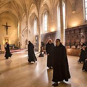 Clothed in their black robes, the distinctive habit of the Benedictine order, the monks leave the heart of the abbey in silence and go about their business. 05-05-16<br /> Vêtus de leur coule noire, l'habit distinctif de l'ordre des bénédictins, les moines quittent le coeur de l'abbatiale en silence et vaquent à leurs activités. 05-05-16