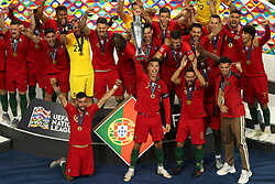 Portugal's Cristiano Ronaldo (centre) lifts the Nations League Trophy with team-mates after the Nations League Final at Estadio do Dragao, Porto.
