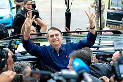 October 7, 2018 - Rio de Janeiro, Brazil - Brazilian presidential candidate of the Social Liberal Party JAIR BOLSONARO arrives at a polling station during the general elections, in Marechal Hermes. Brazilians began to cast votes in the general elections on Sunday expected to produce a new president and state and federal legislators. (Credit Image: © Agencia Estado/Xinhua via ZUMA Wire)