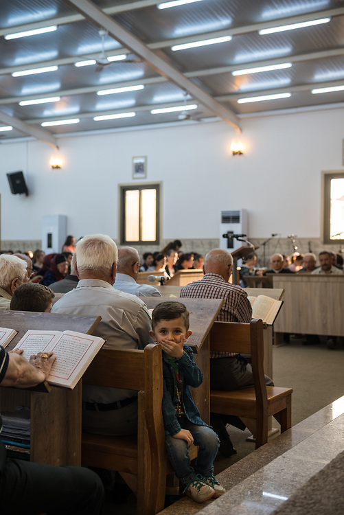 Iraqi Christians worship at the Mart Shmoni church, a Syriac Catholic church in Ankawa, a suburb of Erbil, Iraq. Most of the parishioners are IDPs, pushed out of their homes in Qaraqosh during the 2014 ISIS advance. (May 2, 2017)
