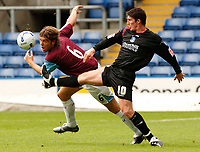 Photo: Henry Browne.<br /> Crystal Palace v West Ham United. Pre Season Friendly.<br /> 30/07/2005.<br /> Jon Macken of Palace gets a foot up in front of West Ham's Elliott Ward.