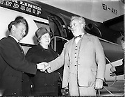 6/04/1960<br /> 04/16/1960<br /> 16 April 1960<br /> Mr and Mrs Uffa Fox arrive in Dublin Airport for Boat Week, welcomed by Phil Kane (left) boat builder of Dublin.