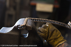 """Sean Guardado working during a visit to brothers Shaun and Aaron Guardado's Suicide Machine shop in Long Beach as they finish their """"Speed and Style"""" Street 750 Harley-Davidson for it's debut at Born Free-7. CA, USA. . June 25, 2015.  Photography ©2015 Michael Lichter."""