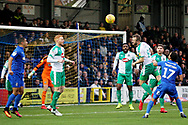 Plymouth midfielder David Fox (8) clears this cross during the EFL Sky Bet League 1 match between AFC Wimbledon and Plymouth Argyle at the Cherry Red Records Stadium, Kingston, England on 26 December 2018.