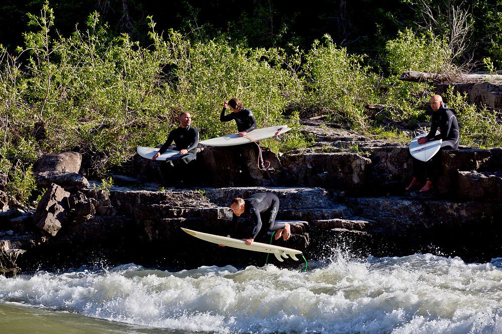 Surfers on the Hoback section of the South Fork of the Snake River surfs a rapid called Lunch Counter on an early June afternoon in Wyoming