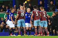 West Ham's James Tomkins receives a yellow card - Everton vs. West Ham United - Barclay's Premier League - Goodison Park - Liverpool - 22/11/2014 Pic Philip Oldham/Sportimage