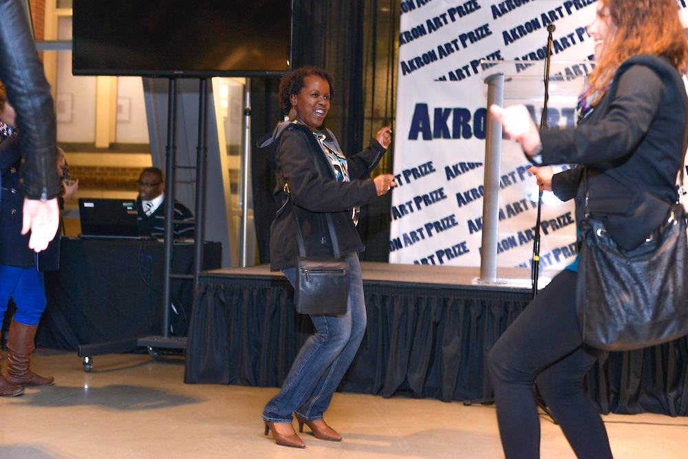 Women dancing and having fun at the Akron Art Prize 2014 Grand Finale at the Akron Art Museum.