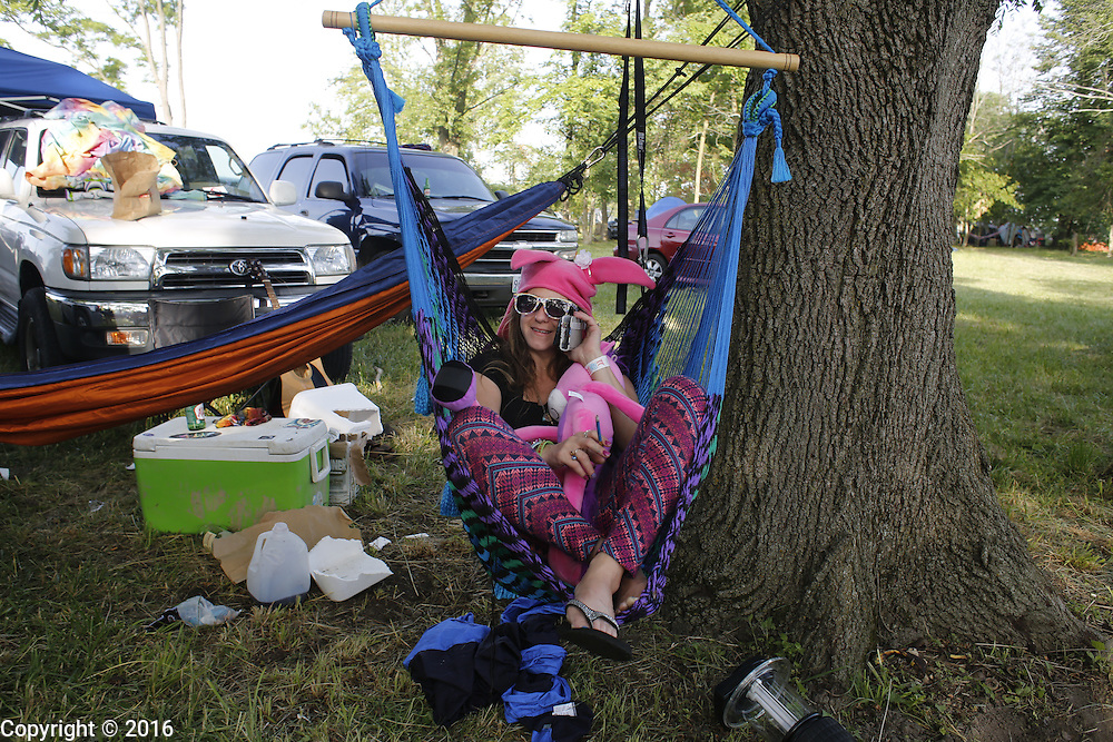 06212016 - Noblesville, Indiana, USA: A neo-prankster sits in a hammock at Backstage Campground near Klipsch Music Center (Deer Creek) after members of the Grateful Dead performed as Dead and Company. The Grateful Dead's final show at  Deer Creek in July 1995 was marred by over a thousand fans crashing the gates leading to the next day's show being canceled. Grateful Dead guitarist Jerry Garcia died a few weeks later. (Jeremy Hogan/Polaris)