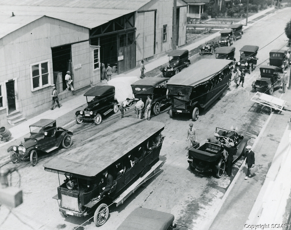 Studio buses filled with actors & crew at Morosco-Bosworth Studios at 201 Occidental in Los Angeles (correct name?)