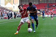 Joe Bryan (3) of Bristol City battles for possession with Fraizer Campbell (25) of Hull City during the EFL Sky Bet Championship match between Bristol City and Hull City at Ashton Gate, Bristol, England on 21 April 2018. Picture by Graham Hunt.